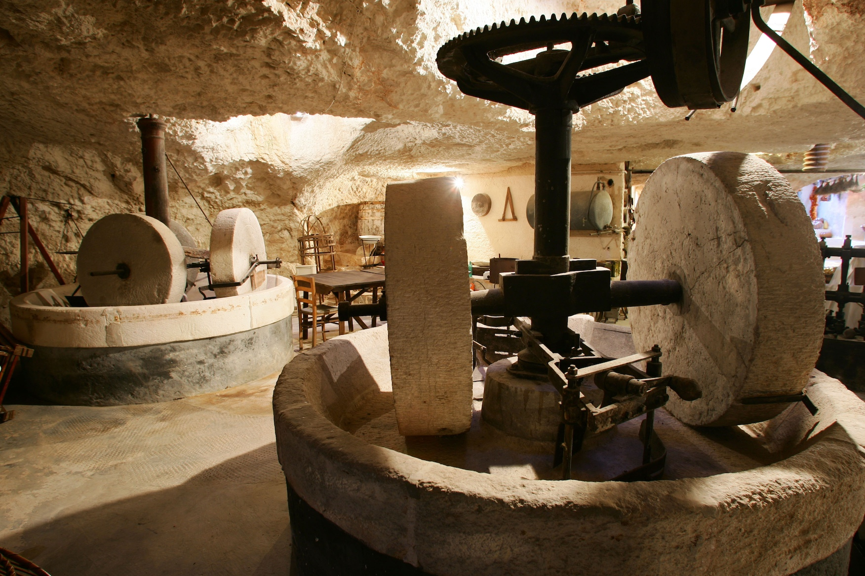 MASSERIA IL FRANTOIO, OSTUNI ( BRINDISI, APULIA, ITALY ) The white Masseria Il Frantoio stands in the countryside of Ostuni, only a few minutes by car from the seaside. We are in the heart of Apulia. In the photo:The hypogeum olive-press of the Frantoio in Ostuni. One of the most fascinating parts of this farm is the huge hypogeum olive-press, named after it. In this natural cave they used to produce olive oil. Almost all of the fortified farms of the Salento area were either built over or near huge underground cavities that man had adapted to his needs: here were placed millstones, presses and tanks.